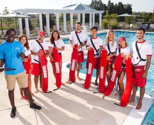 photo of a group of lifeguards at a summer community pool